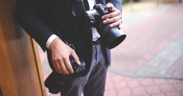 man-hands-photographer-cameras-large